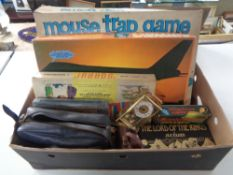 A box of vintage board games, Mouse Trap, Lord of the Rings box set,