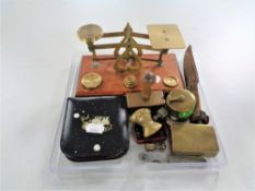A set of vintage brass postal scales with weights, vesta cases, brass trench art matchbox holder,