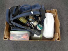 A box containing a large quantity of fishing equipment to include reels, line tackle etc.