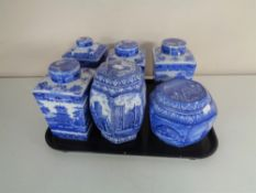 A tray of six assorted Ringtons blue and white caddies
