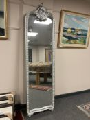 A silvered crested mirror, height 207 cm.