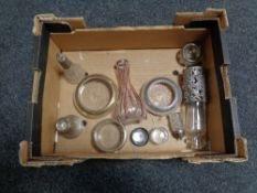 A box of various silver topped items