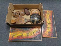 A box of tribal wall masks, bellows,
