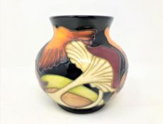 A modern Moorcroft bulbous vase decorated with mushrooms on blue ground, height 11cm.