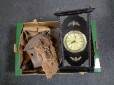 A box containing a contemporary battery operated wall clock in fitted cabinet together with a