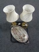 A silver plated twin handled try containing cake slices and tongs,