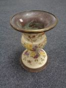A nineteenth century brass and ceramic jardiniere stand