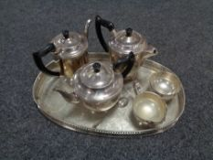 A silver plated serving tray containing five piece Viner's plated tea service