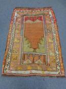 A Iranian prayer rug,