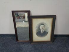 An Edwardian oak framed bevelled mirror together with an oak framed portrait of a man
