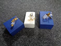 Three boxed Swarovski crystal ornaments to include golf clubs and bag,
