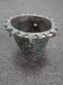 A pottery vase with sunburst rim signed to base