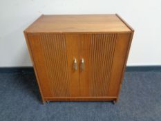 A mid 20th century teak double door record cabinet.