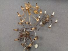 A decorative brass eight way light fitting together with two further copper light fittings.