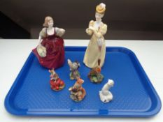 A tray of two bone china lady figures, five small Border Fine Arts figures including squirrel,