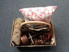 A box of wooden finials, curtain rings, cushion,