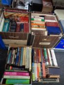 Four boxes containing assorted books to include Penguin paperback novels, Tolkien, reference etc.