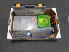 A box containing fishing equipment to include lures, line hooks, plastic cases etc.