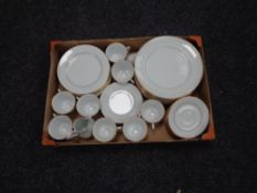A box of Noritake Regency gold tea and dinner service