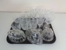 A tray of assorted drinking glasses,