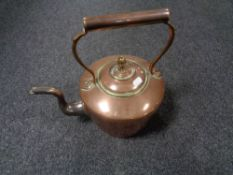 A Victorian brass and copper kettle