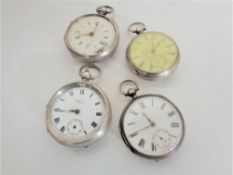 Four silver pocket watches - Waltham USA and three others.