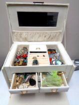 A large box of costume jewellery, sterling silver pendants, white metal bracelets etc.