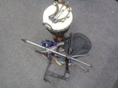 A drum, four various guitar/instrument stands, a soft carry case for a mandolin, guitar straps,