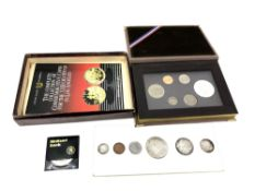 A collection of various silver coins and coin sets