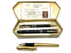 A boxed pen and pencil set with original receipt from 1956 and a 14ct gold filled Parker with 14ct