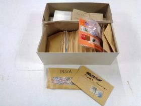 Two boxes of loose stamps, World and GB.