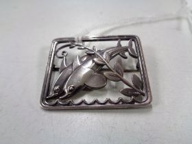A Georg Jensen sterling silver brooch modelled as two dolphins, 37 mm x 30 mm, numbered 251.