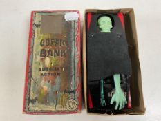 A mid 20th century tin plate coffin bank, boxed.
