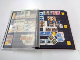 An album of stamps - GB commemorative single mint sets,