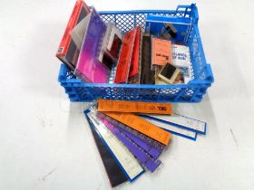 A crate of Prinz strips, Stanley Gibbons albums etc.