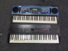 A Yamaha keyboard with power lead, and a Casio keyboard, lacking lead.