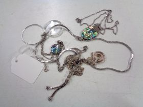 Five sterling silver and continental white metal chains with pendants.