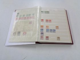 A stamp dealing album - GB Definitives, mixed quality used, lightly hinged mint and mint stamps.