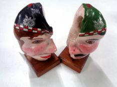 An unusual pair of hand painted shells mounted on wooden plinths, height 15 cm.