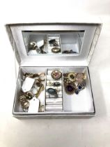 A box of costume jewellery, brooches, necklaces etc.
