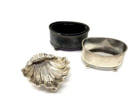Two silver mustards, one with liner, and a silver oyster shell salt.