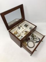 A reproduction jewellery casket containing vintage and later costume jewellery, dress rings etc.