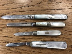 Three antique silver and mother of pearl handled fruit knives, plus one with stainless steel blade.