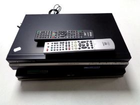 A Sony high definition DVD recorder with remote together with a further Hitachi DVD recorder with