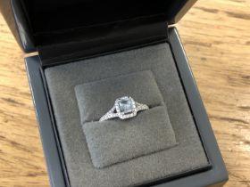 An 18ct white gold diamond and aquamarine ring, total diamond weight 0.