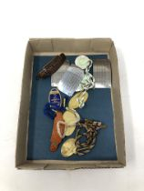 A box containing railway and horse racing memorabilia including badges, enamel fobs.
