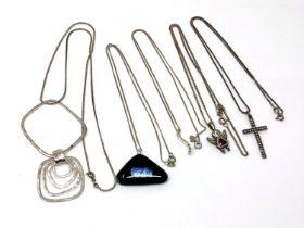 Five silver pendants/necklaces.