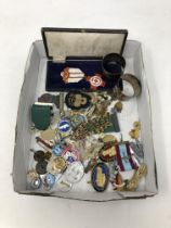 A box containing miscellaneous badges, commemorative medals, napkin rings etc.