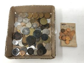 A box of coins to include uncirculated half pennies, commemorative FA Cup coins,