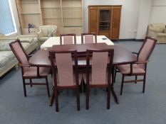 A 20th century Stouby twin pedestal extending dining table with two leaves and six chairs,